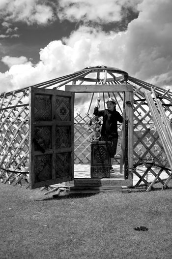 Construction Mongolia Architecture Black And White Building Exterior Built Structure Casual Clothing Cloud - Sky Day Lifestyles Nomadic Nomadic Life Outdoors Real People Sky Standing Steppe Yurt Монгол улс гэр