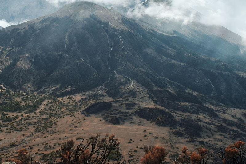 High angle view of mountain range against sky, mount meru, arusha national park, tanzania