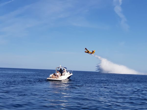 Fire Fire Plane Securite Civile Whaooo Water Nautical Vessel Spraying Sea Men Blue Sailing Motion Sky Yacht Sailboat Cruise