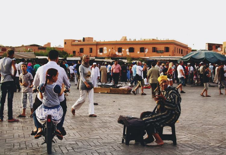 Adult Architecture Building Exterior Built Structure Clear Sky Cobra Day Desert Enjoyment Full Length Guitar Large Group Of People Leisure Activity Lifestyles Marrakech Men Morocco Outdoors People Real People Sky Square Togetherness Women