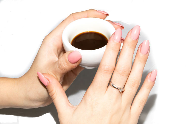 Taking the neapolitan coffee in ceramic cup Aroma Background Beverage Blank Body Break Breakfast Cafe Caffeine Casual Ceramic Clean Close Closeup Coffee Colorful Cup Cups Detail Drink Espresso Female Food Friend Hand Holding Home Man Mocha Model Morning Nail Varnish Pause person Refreshment Relax Standing Student Take Tea Template Time Two View Warm White Women
