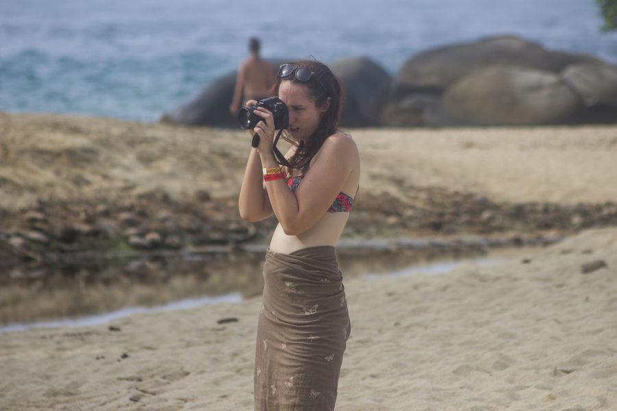 Beach Beautiful Woman Beauty In Nature Camera - Photographic Equipment Day Digital Single-lens Reflex Camera Focus On Foreground Nature One Person Real People Sand Sea Shore Tayrona Tayrona Natural Park Tayrona, Colombia Tayronanationalpark Vacations Young Adult