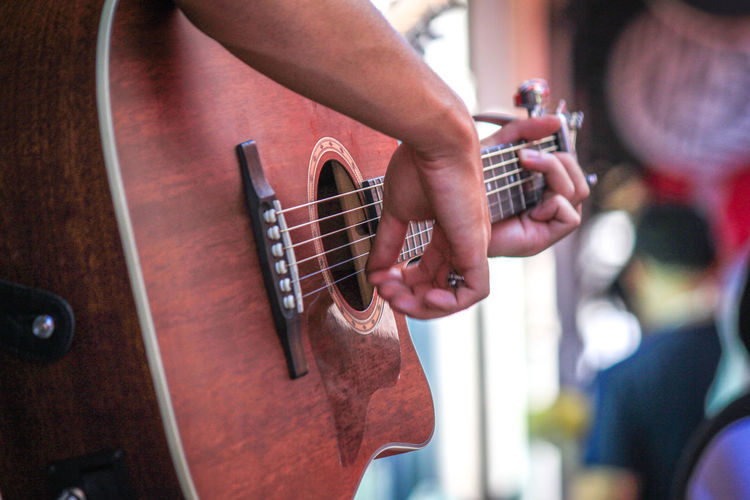Young man hands playing acoustic guitar, close up Arts Culture And Entertainment Close-up Day Electric Guitar Focus On Foreground Fretboard Guitar Human Body Part Human Hand Indoors  Men Music Musical Instrument Musical Instrument String Musician Occupation One Person People Performance Playing Plucking An Instrument Real People Skill