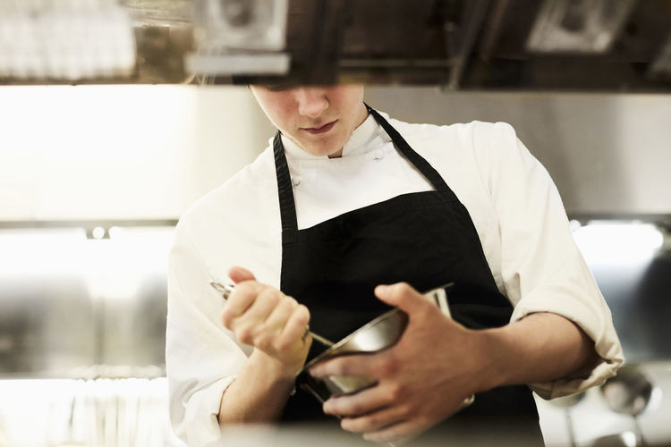 Midsection of man working in restaurant