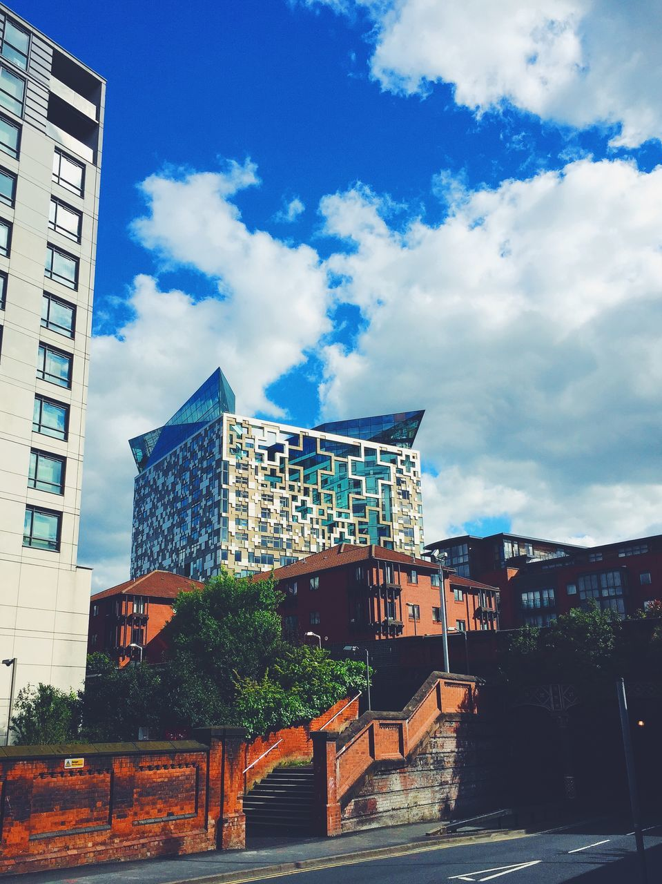 architecture, building exterior, built structure, sky, cloud - sky, outdoors, low angle view, no people, day, tree, city