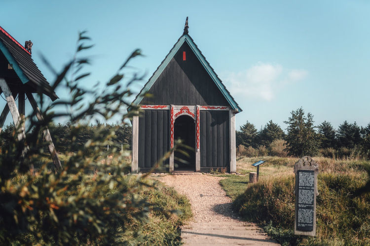 Viking church on field against sky