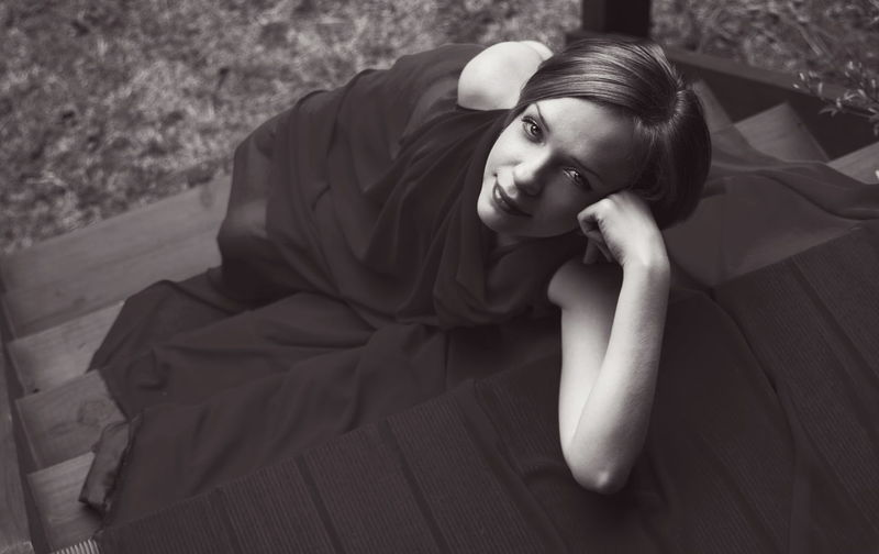 High Angle Portrait Of Beautiful Woman Wearing Dress While Sitting On Steps
