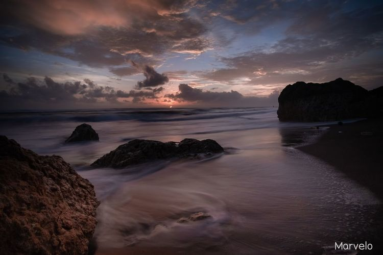 Rock and Sea Longexposure Fujifilm_xseries INDONESIA Indonesia_photography Sun Landscapes Fujifilm Clouds And Sky Astronomy Water Sea Sunset Beach Wave Low Tide Reflection Sky Landscape Seascape Horizon Over Water Coastal Feature Calm Romantic Sky Ocean Tide Coast Dramatic Sky