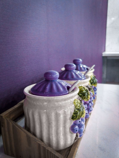 Close-up of purple flower in vase on table at home