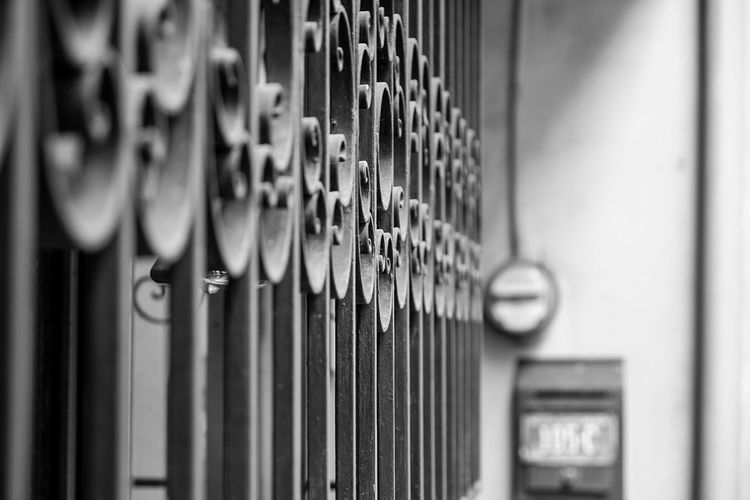 In A Row Metal Selective Focus No People Indoors  Large Group Of Objects Close-up Day Library Bookshelf Monochrome Monochrome Photography Black And White Blackandwhite Blackandwhite Photography Black & White Built Structure Metal Grate Gate Monochrome _ Collection MonochromePhotography Black And White Photography Metal Industry Metalwork