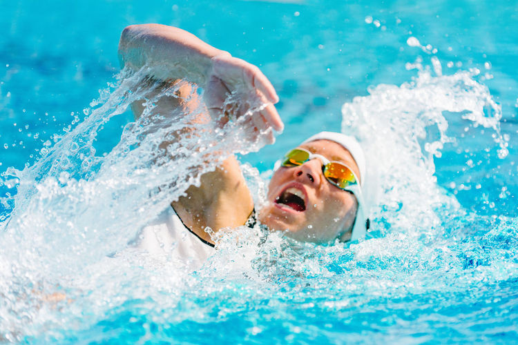 Female Swimmer on Training in the Swimming Pool Swimmer Female Crawl Front Crawl Young Pool Competition Healthy People Active Swimming Cap Swimming Pool Energy Exercise Professional Woman Strength Adult Muscular Lifestyle Activity Race Face Acton Winner Open Mouth Splashing Splash Motion Health Skill  Caucasian White Exercising Training Healthy Lifestyle Sports Training Beautiful Outdoors Color Image Blue Sport Mouth Open Swimming Water Swimming Goggles
