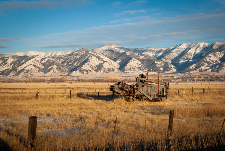 Of Mountains and Machines Architecture Beauty In Nature Day Field Landscape Mountain Nature No People Oil Pump Outdoors Scenics Sky