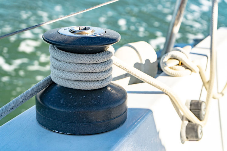 Rope Metal Nautical Vessel Water Focus On Foreground Transportation Mode Of Transportation Strength No People Day Cleat Sea Tied Up Close-up Bollard Outdoors Pulley Sailboat Post Steel Nautical Equipment Yacht Alloy