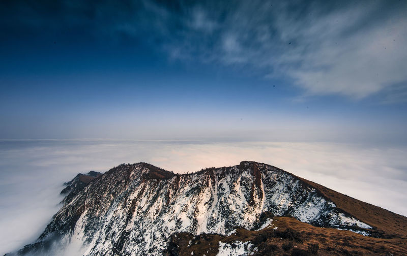Scenic View Of Snowcapped Mountain And Cloudscape Against Sky