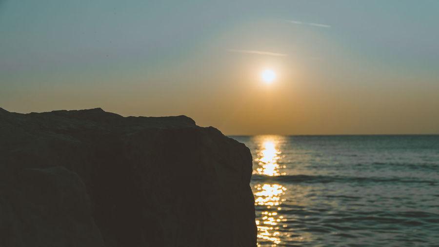 Sunrise over ocean Sunlight Beach Beauty In Nature Horizon Horizon Over Water Idyllic Land Nature No People Outdoors Paradise Reflection Rock Scenics - Nature Sea Sky Summer Sun Sunlight Sunrise Sunset Sunshine Tranquil Scene Tranquility Water
