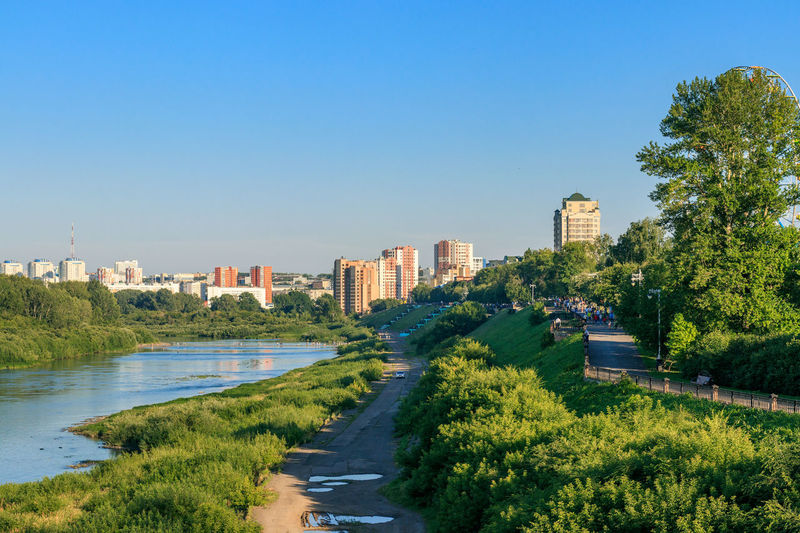 Embankment in Kemerovo city. Riverside Architecture Blue Building Exterior Built Structure City Cityscape Clear Sky Day Embankment Growth Outdoors River Siberia Sky Summer Tree Water