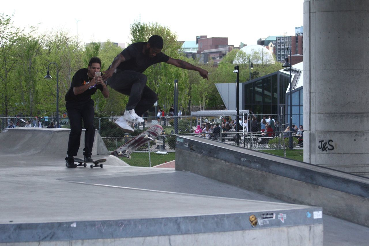 real people, sport, leisure activity, skateboard park, people, men, architecture, full length, group of people, skill, built structure, city, skateboard, lifestyles, building exterior, sports equipment, nature, day, stunt, fun, outdoors