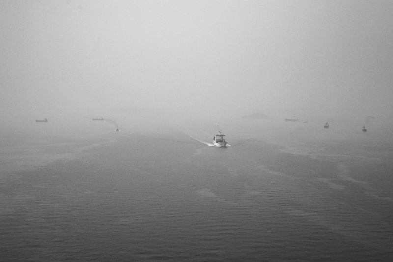 Water Waterfront Transportation Sea Nautical Vessel Mode Of Transportation Fog Beauty In Nature Scenics - Nature Day Tranquility Tranquil Scene Nature Sky Travel Sailing No People Non-urban Scene Outdoors