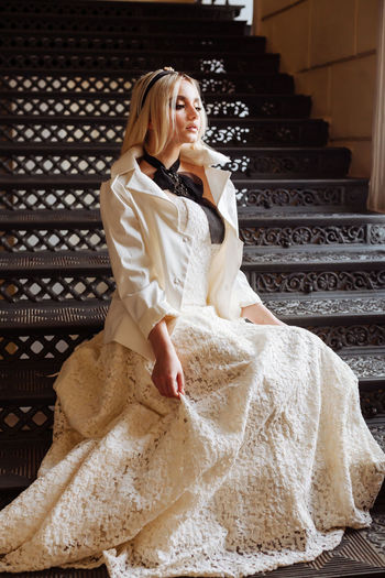 Dressed Up Stairs White Dress Bride Full Length Girl On Stairs Indoors  Looking Real People Sad Mood Sitting On Steps Wedding Dress Wedding Dresses Wedding Mood Fashion Stories