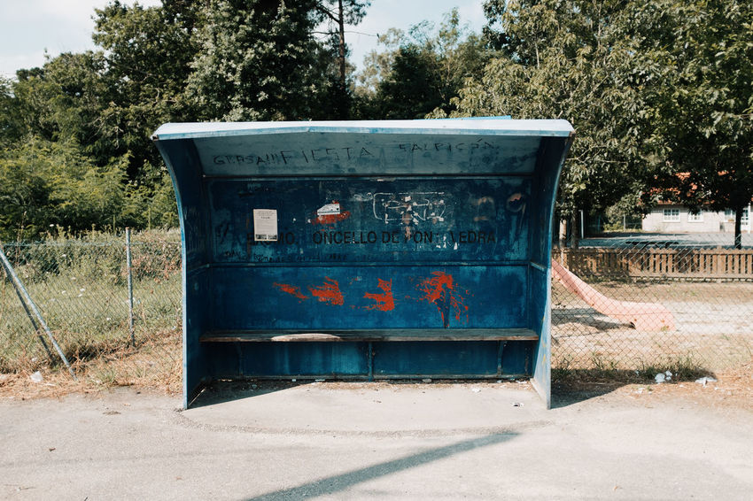 LOST IN GALICIA 🚌 Lostingalicia Tree Nature Day Plant No People Outdoors Abandoned Old Bus Stop Threeweeksgalicia Land Sunlight Field Container Metal Architecture Shadow Environment Obsolete Garbage Bin Rusty Built Structure