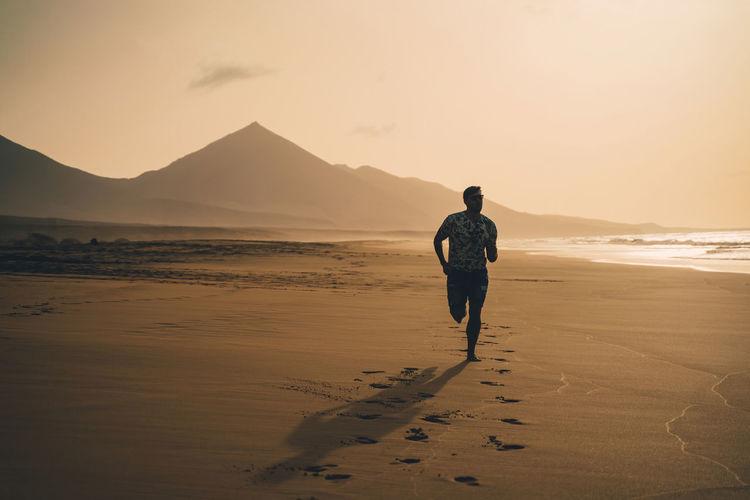 Full length of man running at beach