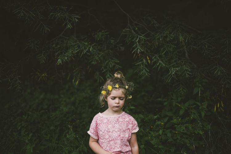 Full length of girl standing by plants