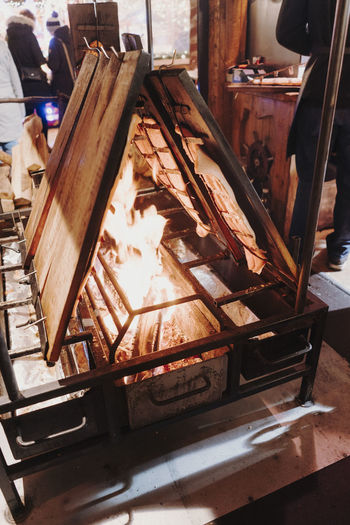 Salmon over wood fire Christmas Market Germany Christmas Christmas Market Christmas Decoration Christmas Lights Indoors  Burning Heat - Temperature Fire Fire - Natural Phenomenon Wood - Material Metal No People Day Flame Nature Close-up Food And Drink Focus On Foreground Table Food Old Preparation  Melting
