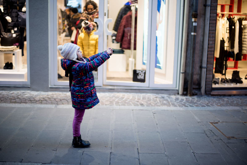 young street photographer Boutique Buying Cheerful Christmas City Consumerism Customer  Day Ecstatic Fashion Full Length Holiday - Event Kid One Person Only Women Outdoors People Retail  Store Streetphotography Window Shopping The Street Photographer - 2017 EyeEm Awards