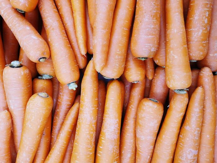 Full frame shot of carrots for sale at market