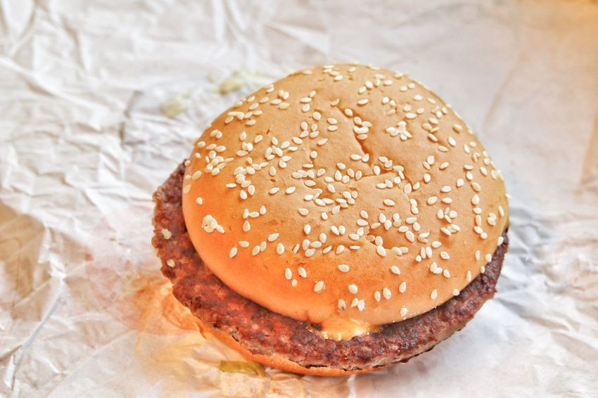 EyeEm Selects Hamburger Burger Unhealthy Eating Bun Indoors  Fast Food Close-up Food And Drink Paper Food Sesame Seed No People Take Out Food Sesame Ready-to-eat Table Freshness Day