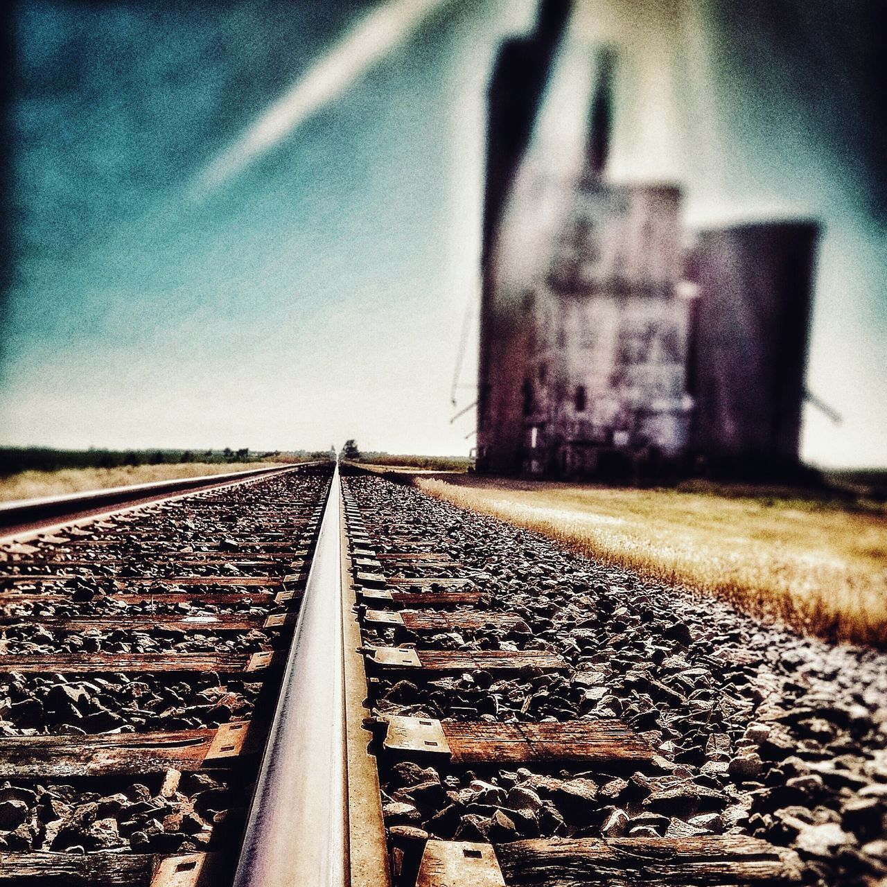 railroad track, rail transportation, transportation, metal, no people, day, railroad tie, the way forward, outdoors, public transportation, railroad, clear sky, sky, close-up