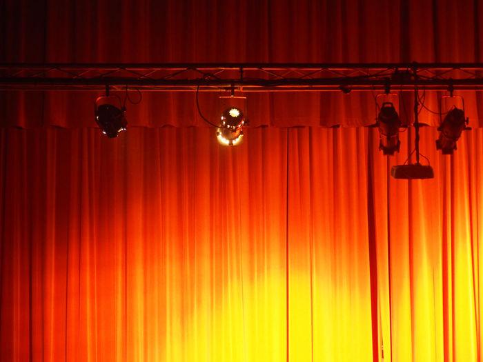 Illuminated lamp against orange sky