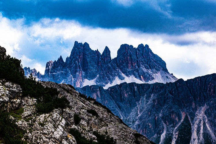 Panoramic view of dolomites mountains against sky