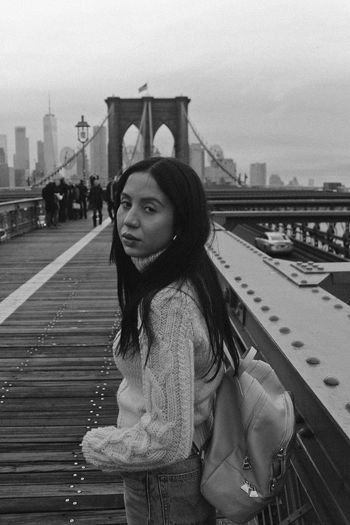 NYC, 2018 One Person Architecture Real People Lifestyles Built Structure Sky City Young Women Transportation Standing Young Adult Women Casual Clothing Hair Waist Up Leisure Activity Railing Building Exterior Warm Clothing Hairstyle Bridge - Man Made Structure Outdoors Brooklyn Bridge  New York NYC Black And White Winter Indie Trip The Portraitist - 2019 EyeEm Awards