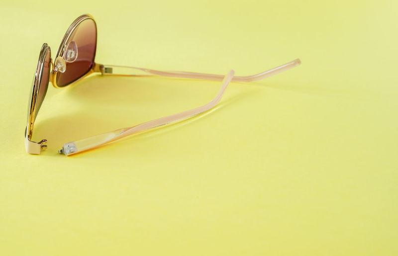 High angle view of yellow eyeglasses on table