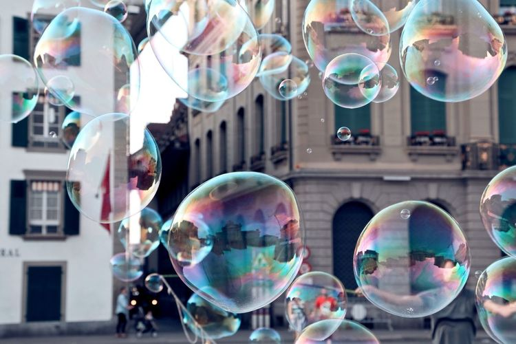 Bubbles On Street Against Buildings