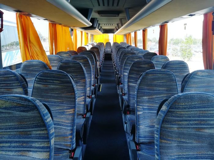 Destination Holidays Confort Aisle Buses Parked Perspective Travel Transportation Transport Nobody Empty Empty Bus Bus Seats Interior Of A Bus Bus Seat Chairs Seats Vehicle Interior In A Row Symmetry Repetition