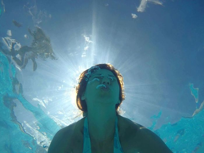 Low angle view of woman swimming in sea