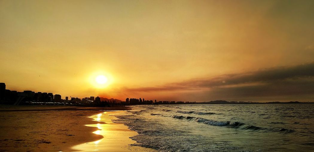 Seaside with gold Water Sea Sunset Beach Low Tide Sand Sun Sunlight Summer Reflection Romantic Sky Seascape Moody Sky
