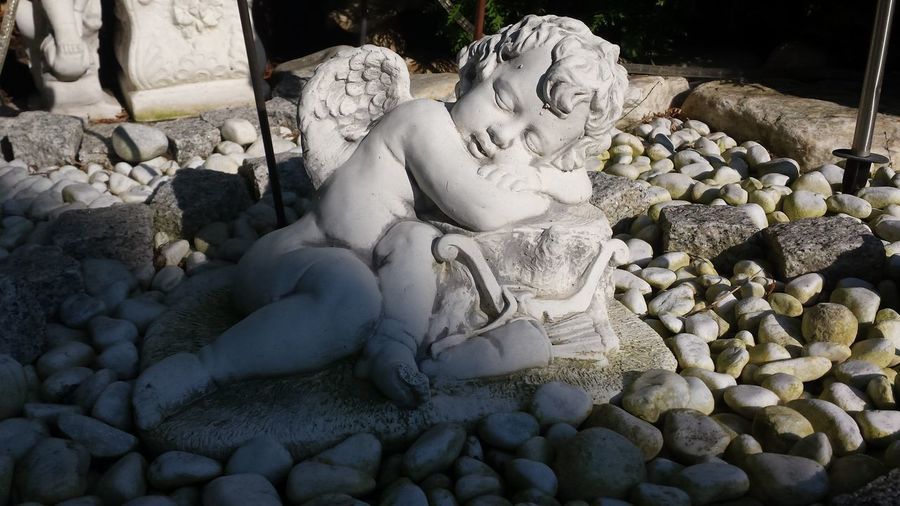 A sleepy angel... Relaxing Hanging Out In The Garden Statues