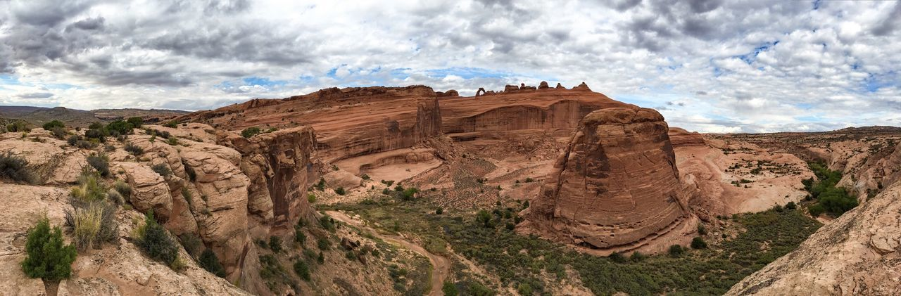 Panoramic view of arches national park against cloudy sky