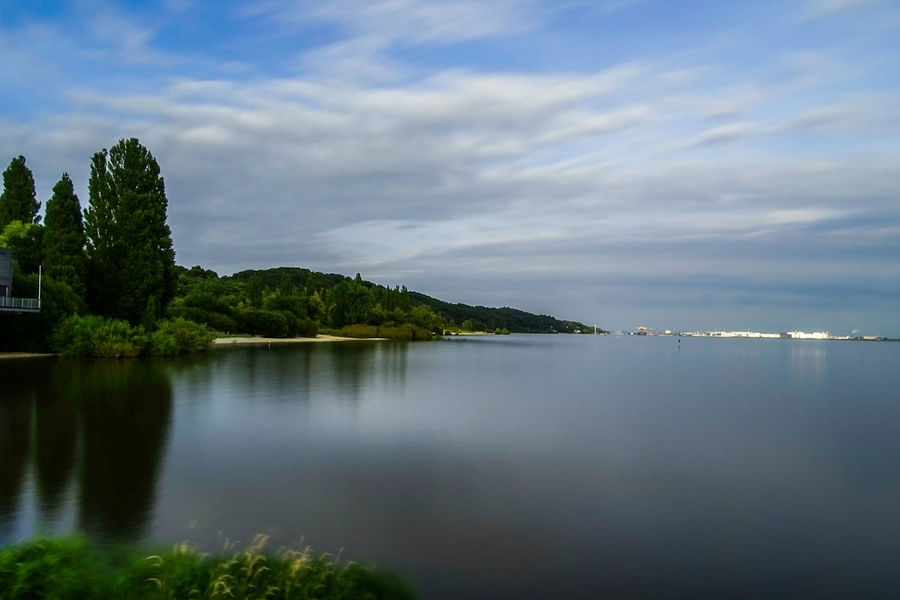 Elbe River Landscape Idyllic Cloud - Sky Tranquility Tranquil Scene Tree Scenics Vacations Nature Sea Reflection Outdoors Social Issues Beauty In Nature Water Beach No People Travel Destinations Sky Awe River