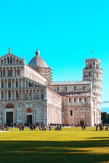 Piazza del Duomo - Pisa Building Exterior Built Structure Sky Architecture Grass Plant Clear Sky Nature Blue Building Green Color Day Copy Space Sunlight History Travel Destinations The Past Outdoors Travel Group Of People
