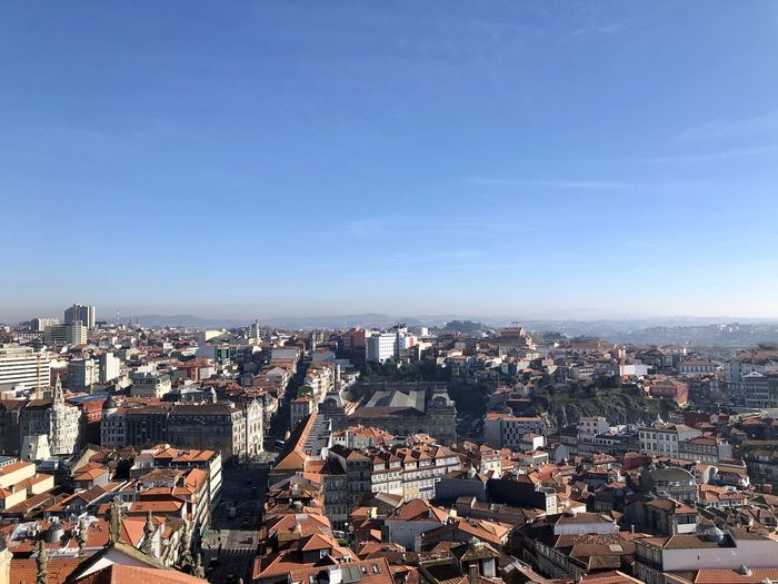High angle view of townscape against clear blue sky, porto, portugal