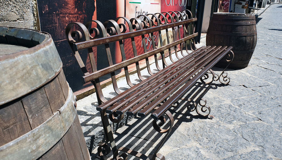 High angle view of empty bench on street