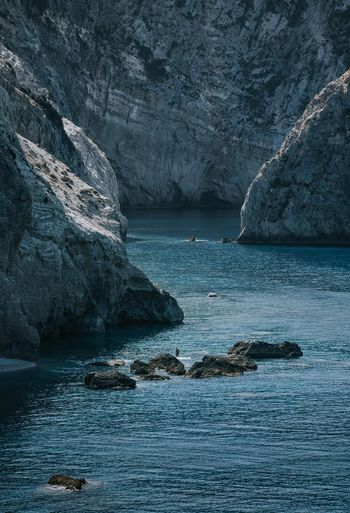 Blue Nature Rock Formation One Person People Landscape Rocks Rocky Coastline Rocks And Water Cliff Sea Water Beach Seascape Rocky Coastline Coastline Geology Rocky Mountains Eroded Coastal Feature Natural Arch Rock