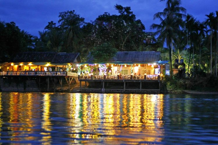 Homestay In Don Khon Mekong River Architecture Built Structure Cafe In The Riverside Caffè Dusk Homestay In 4000 Islands Homestay In Mekong Delta Homestay Vietnam Illuminated Mekong River Cafe Nature Night No People Outdoors Party In The Riverbank Reflection Sky Tree Water Waterfront