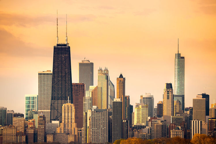 Downtown city skyline of Chicago, Illinois Chicago Illinois Skyline United States Architecture Building Exterior Buildings City Cityscape Dawn Downtown District Modern Skyscraper Sunset Tower Travel Destinations Urban Skyline