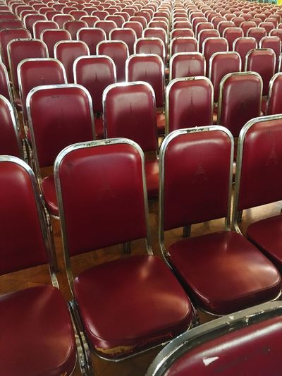 Full Frame Shot Of Empty Red Chairs In Hall