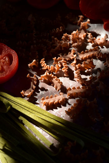 organic ancient grain Farro brown Penne pasta Artisan Pasta Close-up Cookie Day Farro Food Food And Drink Freshness Handmade Pasta High Angle View Indoors  Indulgence Kitchen Still Life No People Pasta Time Preparation  Raw Food Ready-to-eat Uncooked Pasta